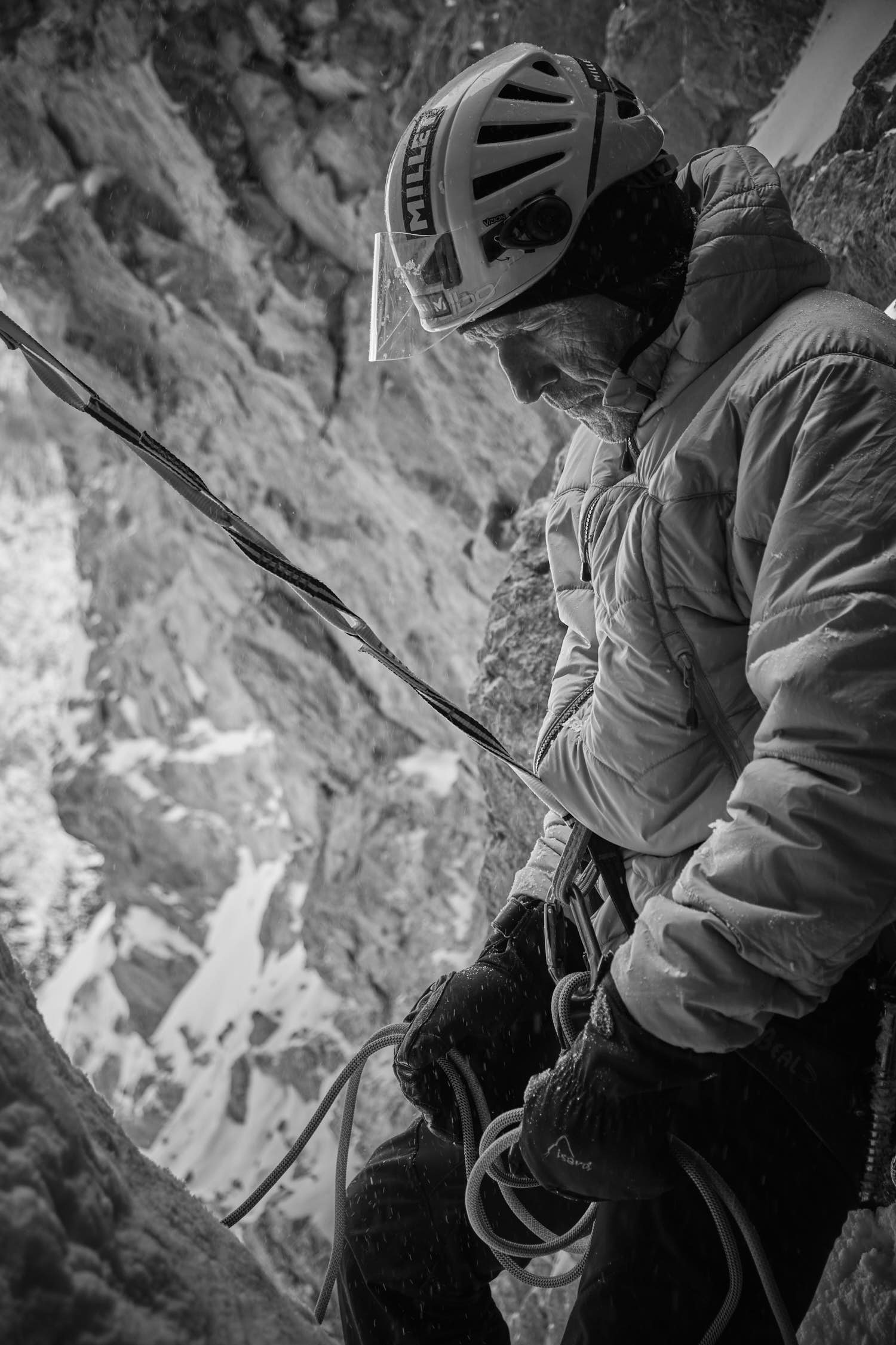 A thoughtful old man belaying. Black and white photography.