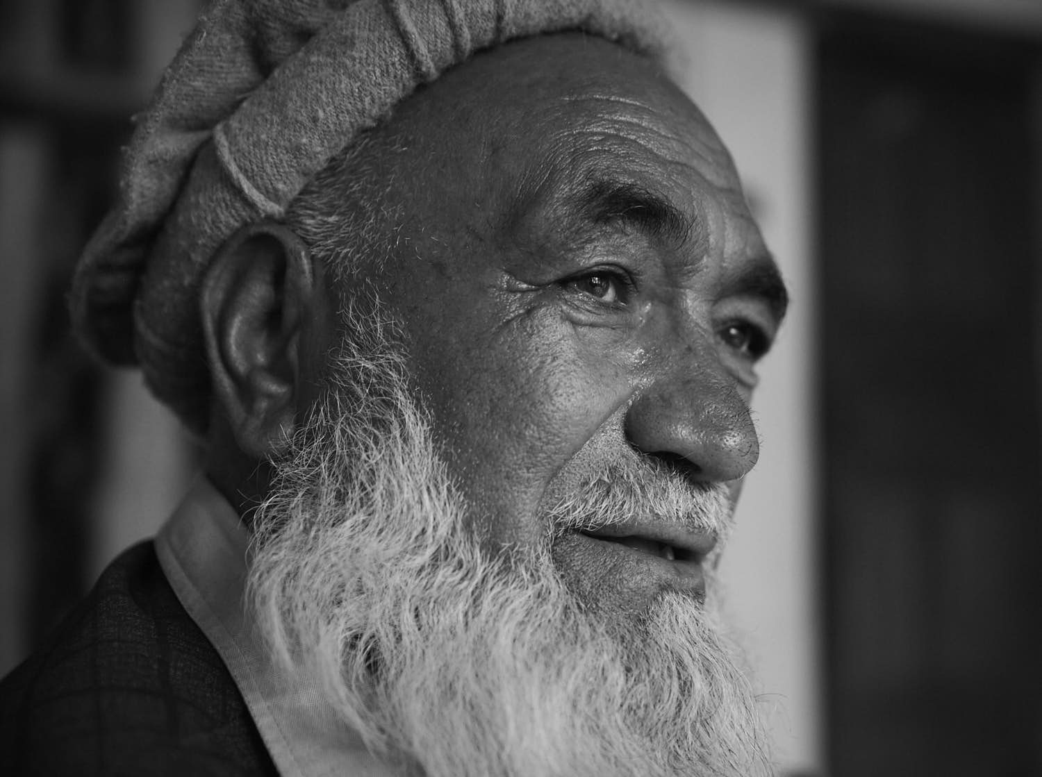 A portrait of a Balti man with a long white beard. Black and white photography.