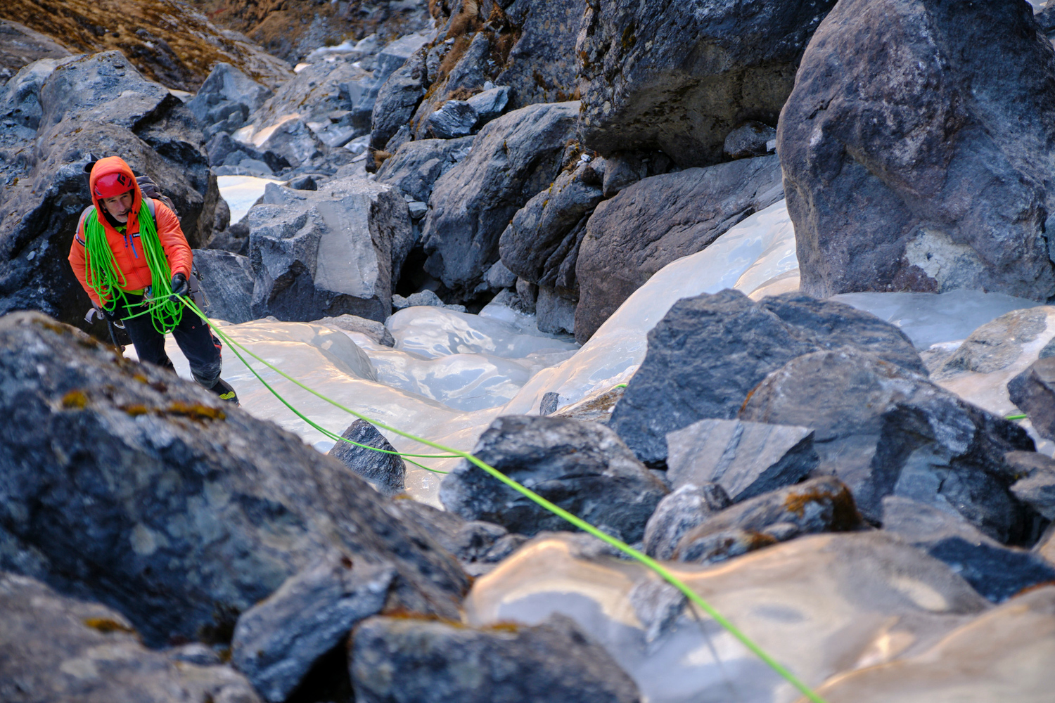 A climber rappeling an ice slope.