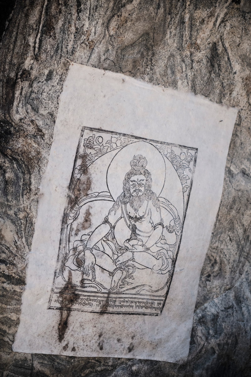 Portrait of Guru Rimpoche sculpted in rock.